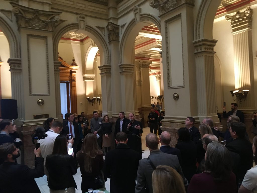 Colorado Governor speaking at blockchain day