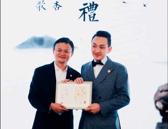 Two Men Taking a Photo Holding a Degree